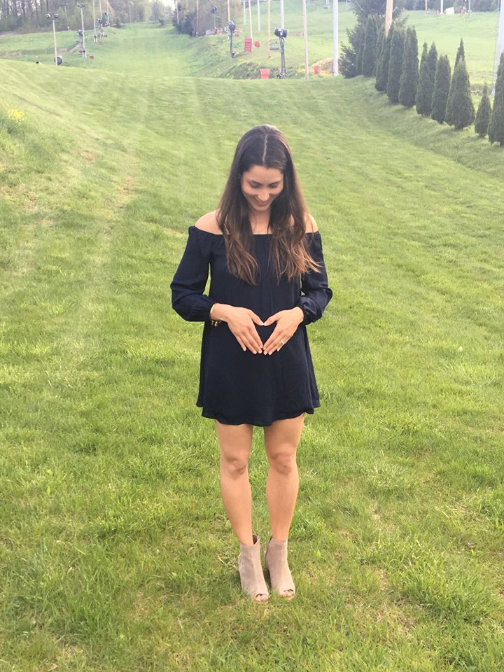 angie holding tummy.jpg